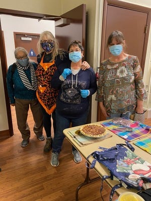 Dunsmuir Rotarians present one of 90 pies they baked as part of a fundraiser last week.  Left to right are Linda Guzman, Wendy Grochol, Cindy Foreman, Kate O'Grady.