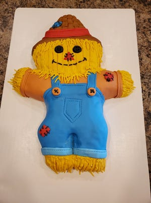 Ashley Hempel won first place in the Pratt Public Library's first-ever cake decorating contest this year with a scarecrow creation.