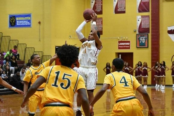 Petersburg guard Milton Coles goes up for a jump shot in this 2019 file photo. Will there be scenes like this in high school gyms this winter?