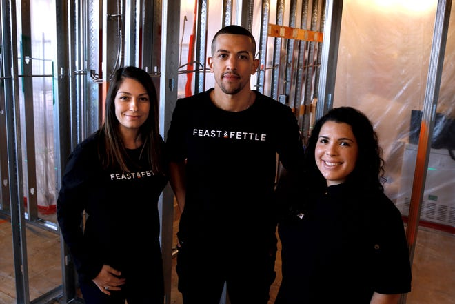 Feast & Fettle's management team includes Nicole Oliveira, Carlo Ventura and founder Maggie Mulvena Pearson. Here they stand amidst construction for their new offices in East Providence.