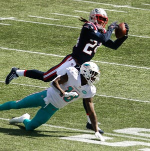 Patriots cornerback Stephon Gilmore intercepts a pass meant for the Miami Dolphins' Preston Williams during the season-opener Sept. 13 at Gillette Stadium.