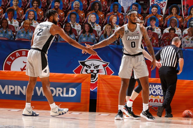 Providence's Kris Monroe (2) and Nate Watson (0) slap hands in the first half of Tuesday's game against Davidson at the Maui Invitational. Watson had a game-high 22 points in the victory.