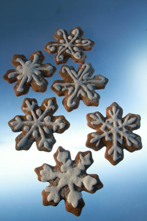 A little frosting makes Ginger Snowflakes look like they fell from the sky. The gingerbread dough tastes pretty fine, too.