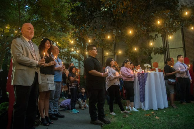 About 60 people attend the Women's center - Youth and Family Services annual Night of Remembrance vigil in memory of those who have died from domestic violence.