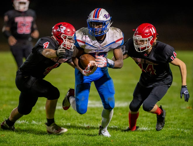 """Kent Roosevelt hosted the rivalry game with Ravenna and left with the """"R"""" 37-7. Kent defenders AJ Powers and Dillinger Sherwood close in on Pavel Henderson."""