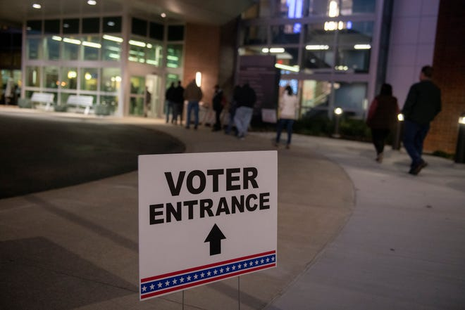 Voters wait outside a polling place at The NEW Center in Rootstown during a recent election.