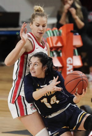 Kent State sophomore guard Katie Shumate (14) drives to the basket as Ohio State forward Dorka Juhasz defends during the first quarter of Wednesday's game at the Covelli Center in Columbus.
