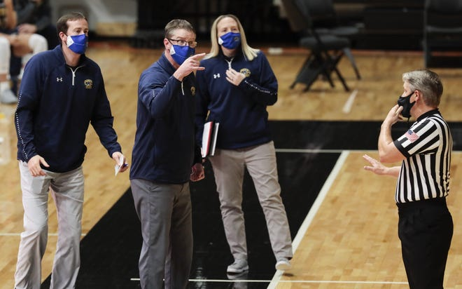 Head coach Todd Starkey (center) and his staff are preparing the Kent State women's basketball team for a busy February, following a 23-day break between games in January due to COVID-19 issues within the program.