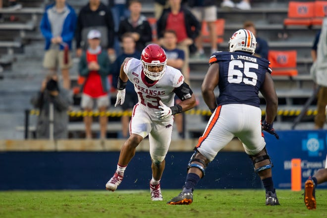 Julius Coates, a former Guilford wide receiver who has grown into a Division I starter on the defensive line for Arkansas, is shown here Oct. 10 during a game against Auburn.