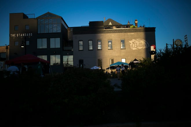 Taco Betty's and The Standard soak up the last rays of the day's sun on East State Street during City Market on Friday, July 10, 2020, in Rockford.