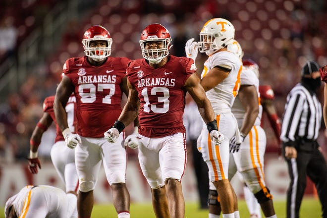 Former Guilford football player and current Arkansas defensive lineman Julius Coates (13) celebrates during a 24-13 win over Tennessee on Nov. 7 in Fayetteville, Ark.