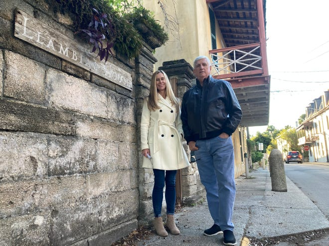 Magen Wilson, executive director of the St. Augustine Historical Society, and Paul Weaver III, president of the society's board of trustees, stand in front of the Llambias House, a national landmark, on Tuesday in St. Augustine. The historical society plans to replace the roof and make other repairs, and perform an assessment of the site to plan for future upgrades.