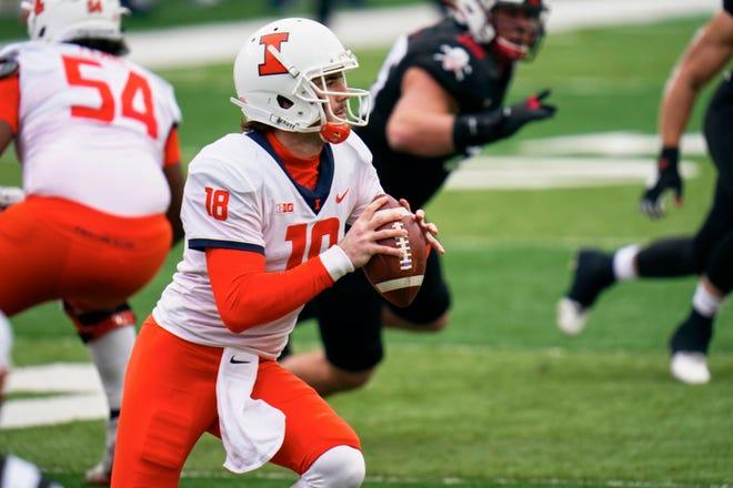 Illinois quarterback Brandon Peters (18) looks to throw Saturday, Nov. 21, 2020, in Lincoln, Neb.