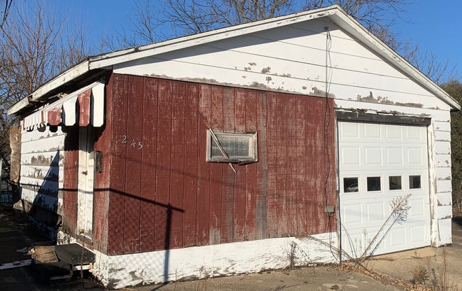 The City Council Monday contracted with Kirk Dana to demolish this garage at 247 Tenney St., which led to a broader discussion about how the city handles building demolitions.