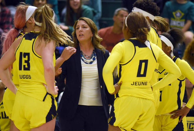 """After missing more than three months due to """"personal reasons,"""" UNCW women's basketball coach Karen Barefoot returned to the program this week."""