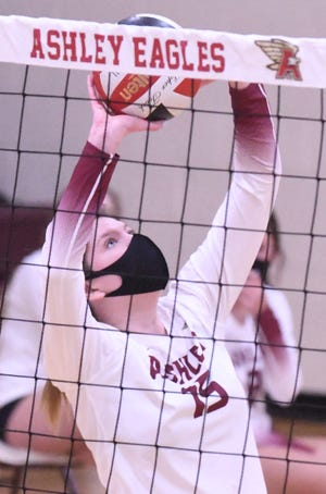 Ashley's Savannah Cook puts up a set against New Hanover during last season. The Screaming Eagles will be looking to the senior for big moments as they chase a conference title. [KEN BLEVINS/STARNEWS]