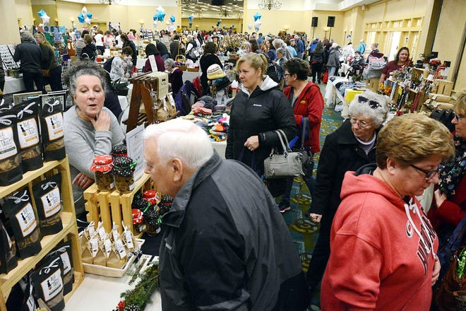 Shoppers check out the items for sale at the 2019 Greater Norwich Area Chamber of Commerce Small Business Saturday at the Norwich Holiday Inn. This Saturday, the chamber will hold an outdoor event in downtown Norwich called the Shop Local Holiday Market.