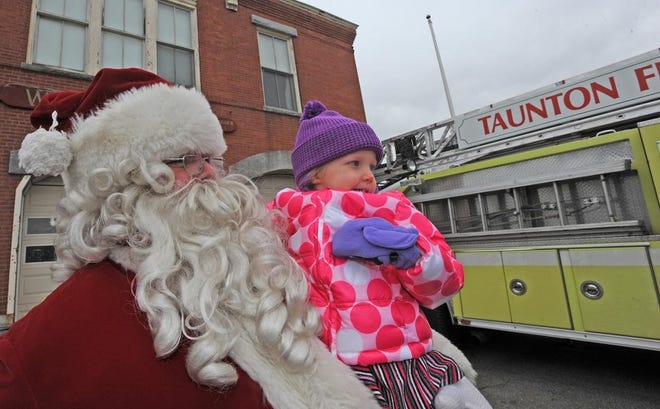 Santa visits with Taylor Batchelder, 3, before he leaves the Weir Fire Station in 2014.