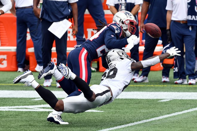 Patriots cornerback Stephon Gilmore, top, breaks up a pass intended for Raiders wide receiver Bryan Edwards during a Gillette Stadium game in September.