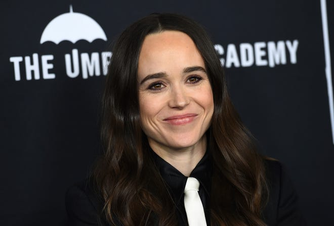 """Elliot Page arrives at the Los Angeles premiere of """"The Umbrella Academy"""" on Feb. 12, 2019. Page, the Oscar-nominated actor of """"Juno"""", """"Inception"""" and """"The Umbrella Academy"""" came out as transgender on Tuesday in an announcement greeted as a watershed moment for the trans community in Hollywood."""