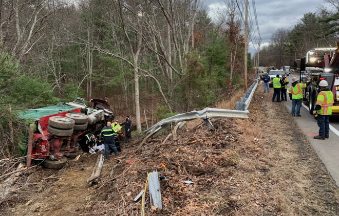 The dump truck went off the road and down an embankment after the head-on collision on Route 16 in Uxbridge.