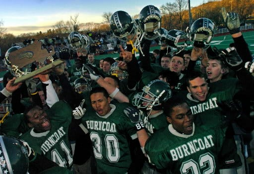 Burncoat celebrates its Central/Western Mass. Division 2 Super Bowl victory over St. Joseph's of Pittsfield in 2003.