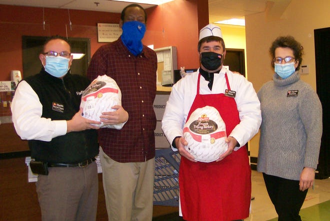 From left, Shop Rite Mgr. Bayarda Villegas, United Way CFO Julian Dawson, Meat Dept. Rep. Glenn Palmatier and Associates and Relations Mgr. Romina Villardi, display donated turkeys.