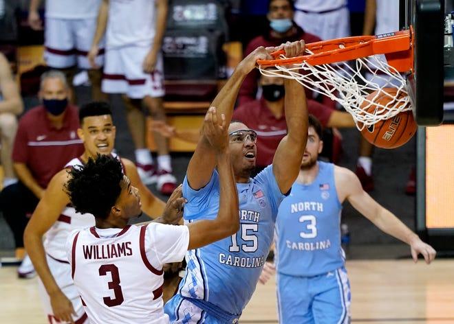 North Carolina's Garrison Brooks dunks over Stanford's Ziaire Williams during Tuesday's semifinal game in the relocated Maui Invitational.