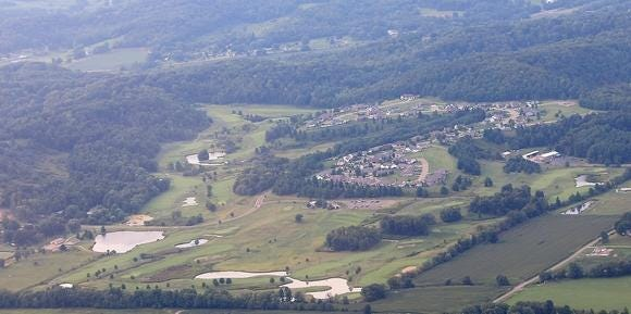 A view of the Oak Shadows Golf Club taken from an airplane.