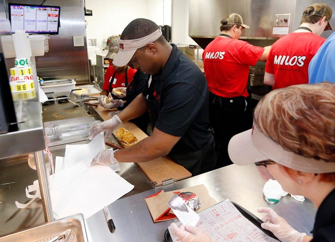 Assistant manager Anthony Blair prepares breakfast biscuits along with other employees at the new location of Milo's on Old Greensboro Road near the corner of Skyland Blvd. and Hwy 69 Tuesday, June 16, 2015. The original Tuscaloosa location was destroyed by the April 27, 2011 tornado. The newly rebuilt location is one of three Milo's locations serving breakfast as well as their traditional menu which has been expanded to include items such as hand-breaded chicken tenders, fresh-made ice cream and hand-spun shakes. Other Milo's locations will begin serving breakfast later this summer. Following a ribbon cutting and soft opening Tuesday at the Tuscaloosa location, Milo's closed for the day and will officially open for business at 6 AM Wednesday. Staff Photo   Michelle Lepianka Carter