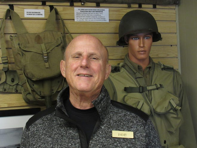 Grove City resident Bob Traphagan stands in front of some of the memorabilia at the Central Ohio Military Museum, 1010 High St. in Harrisburg. The museum is holding its annual fundraising drive through Dec. 20 with a goal of raising $3,500.