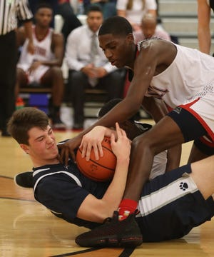 Grant Culbertson (bottom) and Grandview Heights are getting ready for a season that has been delayed by the COVID-19 coronavirus pandemic. Last winter, the pandemic ended the Bobcats' postseason run when they were one win from the Division IV state tournament.