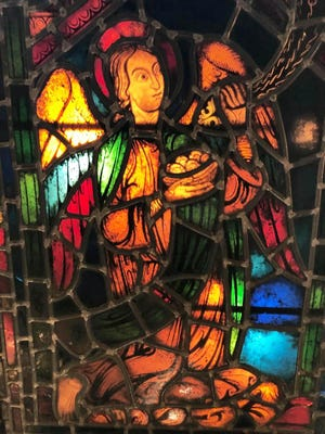 An angel rendered in stained glass at Hammond Castle in Gloucester.
