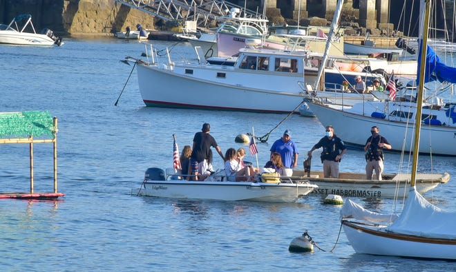Cohasset Police in conversation with a group of boaters in Cohasset Harbor.