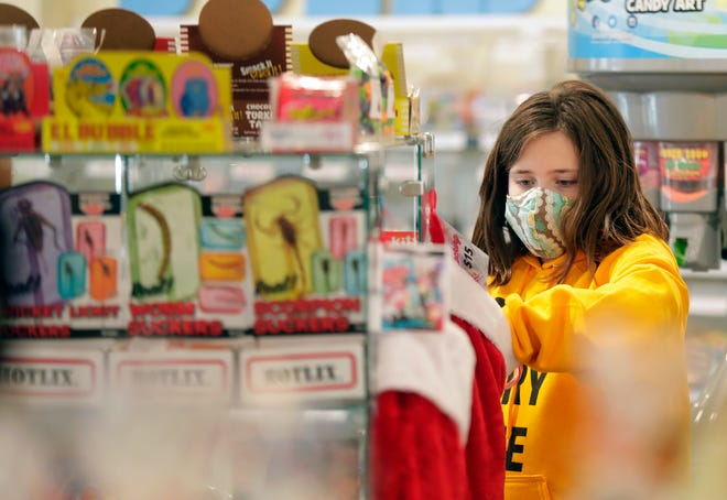 Zoe Stahl at Crazy Sweet, a candy and ice cream shop now open at a new location, 514 W. College Ave., on Wednesday, December 2, 2020, in Appleton, Wis. Wm. Glasheen/USA TODAY NETWORK-Wisconsin