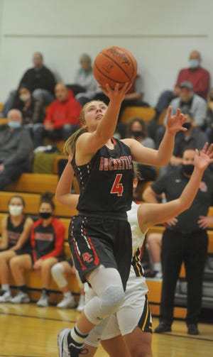 Buckeye Central's Claudia Pifher slips past Colonel Crawford's Allison Teglovic for a layup.