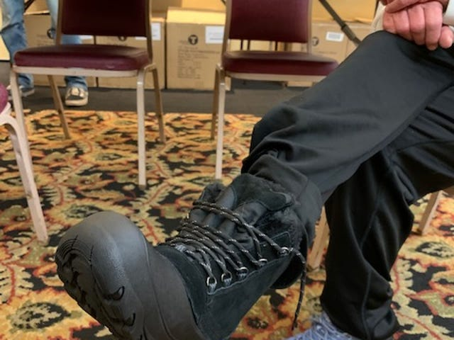 Winter boots donated to homeless housed at Holiday Inn in South Burlington by Lenny's Shoe and Apparel.