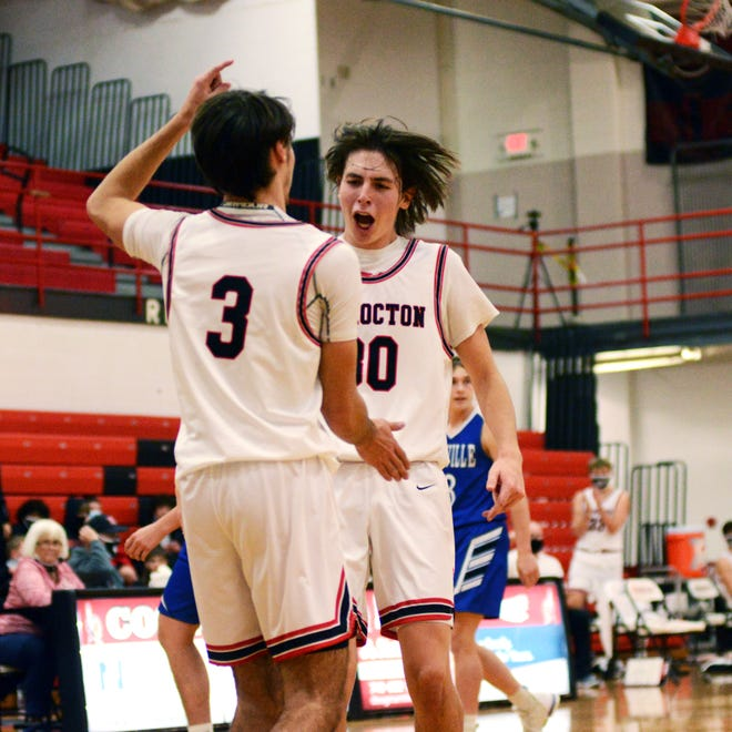 Nathan Fauver, left, and Abe Jarvis celebrate a basket before halftime during host Coshocton's 56-42 win against Danville on Tuesday night at The Wigwam. Jarvis scored a team-high 14 points with four 3-pointers.