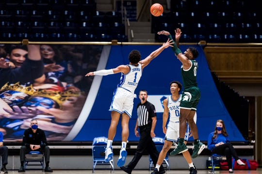 Michigan State's Aaron Henry shoots against Duke during the Champions Classic at Cameron Indoor Stadium in Durham, N.C. on Dec. 1, 2020.