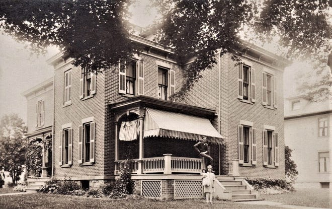 The Italianate-style home was owned by Eva Kirser in 1913.