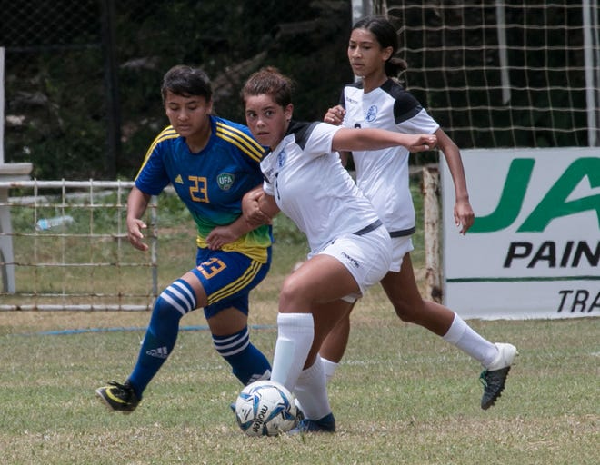 Guam's Samantha Kenney looks for options on the field under pressure from an Uzbekistan opponent during a match of the AFC U16 Women's Championship Qualifier in Sri Lanka in this October 2018 file photo.