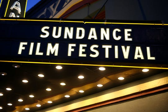 Sundance Film Festival appears in lights on a marquee.