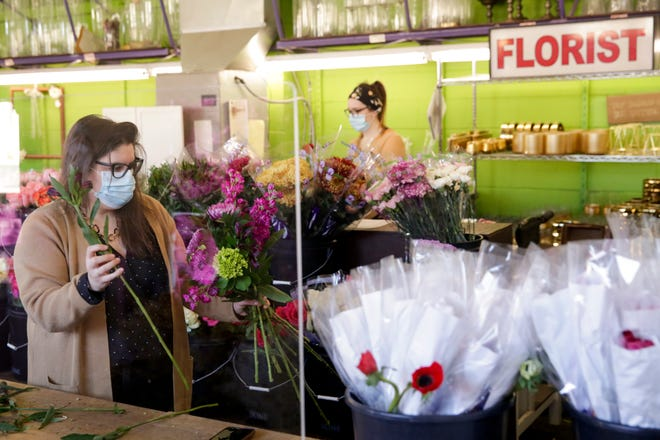 Sarah Harmon, owner, assembles a flower order at Rubia Flower Market, 224 East State St., Wednesday, Dec. 2, 2020 in West Lafayette.