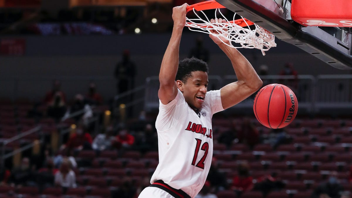 Louisville`s Chris Mack `tickled pink` about growth of...