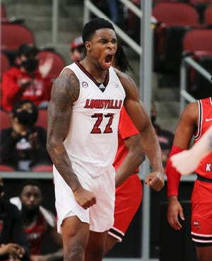 Louisville's Aidan Igiehon (22) reacted after getting a tough shot to fall against Western Kentucky during their game  at the KFC Yum! Center in Louisville, Ky. on Dec. 1, 2020.
