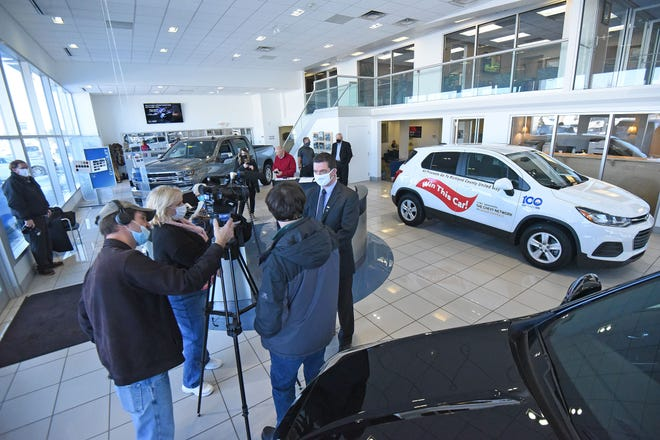 Dan Varn, executive director of United Way of Richland County, answers questions from the media on Wednesday about the vehicle being raffled for the United Way's centennial campaign.
