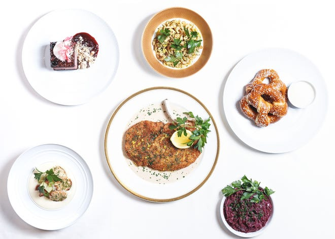 The Alinea group of restaurants in Chicago, which includes Alinea, Next and St. Clair Supper Club, will bring takeout meals to Milwaukee. Shown is Next restaurant's Alps dinner, which includes pork schnitzel, spaetzle, braised cabbage, and dark chocolate-dark cherry cake. Soft pretzels with beer cheese fondue is an optional side.