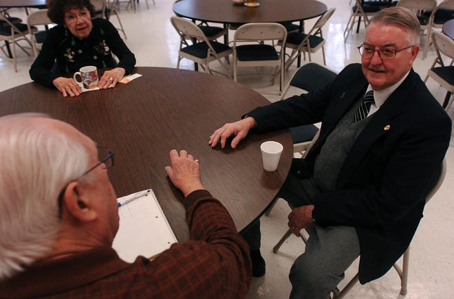Casper Green, of Franklin, talks with senior citizens at the Franklin Senior Meal Site, located at the Franklin City Hall in this 2007 file photo. City officials on Dec. 1 unanimously decided to name Franklin City Hall's community room after Green, who developed it.