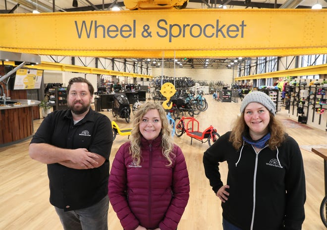 Wheel & Sprocket redeveloped a former industrial building that includes an overhead crane and made it into a store in Milwaukee's Bay View neighborhood. The company is led by Noel Kegel and his sisters, Tessa Kegel and Amelia Kegel, shown left to right, in this photo from December 2020.