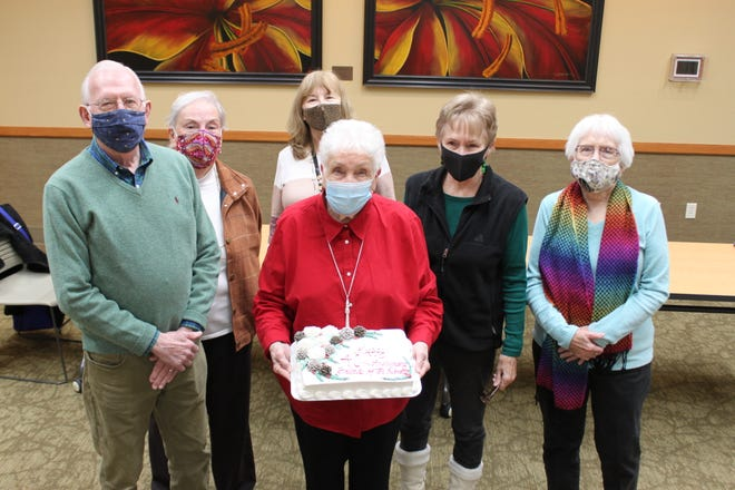 The Friends of the Library Board Members celebrate the organization's 40th Anniversary with a custom cake. Pictured from left are Nealus Wheeler, Janet Wheeler, Margie Kelly, Maureen Rozelle, Carolyn Clark, and holding the cake is JoBelle Zimmerman. Not pictured are Kathryn Bauwens, Eileen Jenkins, Carolyn Densmore, Phil Garner, Nancy Knopp, Evelyn Quinn, Laura Taylor, and Mary Lou Duseberg.